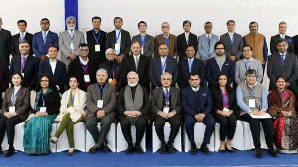 Prime Minister Narendra Modi in a group photograph with the Economists and Experts, at NITI Aayog, in New Delhi on Thursday. (Photo: ANI)
