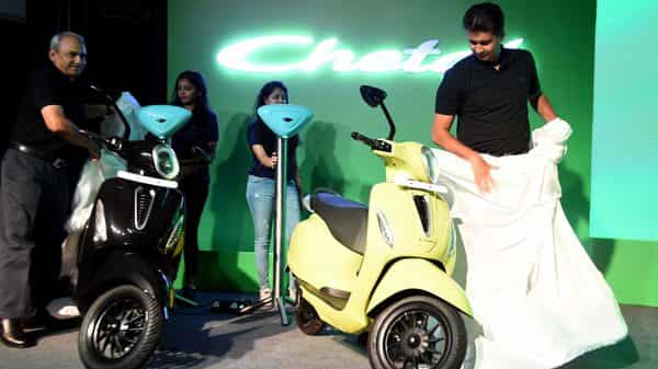 Executive Director of Bajaj Auto Rakesh Sharma along with Managing Director of Bajaj Auto Rajiv Bajaj during the launch of first electric scooter (Bajaj EV Chetak) with prices starting at  ₹1 lakh, in Mumbai. (ANI)