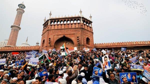 Demonstrators holding placards of Bhim Army chief Chandrashekhar Azad protest against CAA and NRC, at Jama Masjid in New Delhi on Friday. (ANI Photo)