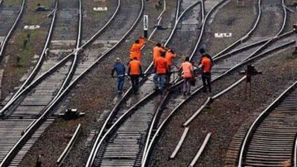 Indian railway workers inspect the tracks. (AP)