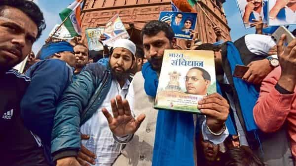 Bhim Army chief Chandrashekhar Azad holding a copy of the Constitution at the Jama Masjid in Delhi.  (Photo: Getty Images)