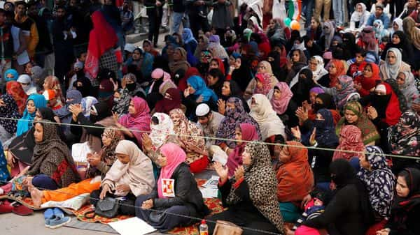 Demonstrators during the ongoing sit-in protest against the CAA and NRC, near Jamia Millia Islamia University, in New Delhi. (ANI)