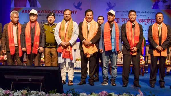 Assam Chief minister Sarbananda Sonowal (4th R) with National Democratic Front of Bodoland (NDFB) chief Ranjan Daimary (2nd R), NDFB leader B Saoraigra, NDFB-P (Progressive) president Gobinda Basumatary (2nd L) and others poses for photographs during an arms laying down ceremony in Guwahati. (PTI)