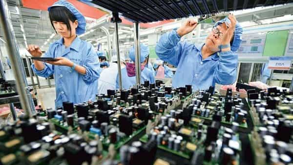 Workers at an electronics factory in Wuhan, the originating point of the new coronavirus. (Reuters)