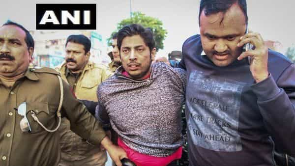 Man who fired in Delhi's Shaheen Bagh being been taken into custody by police (Photo: ANI)