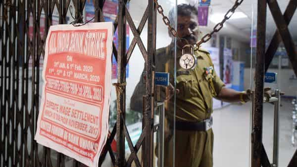 The main gate of a nationalised bank remains closed during a two-day nationwide bank strike, in Chennai.  (PTI)