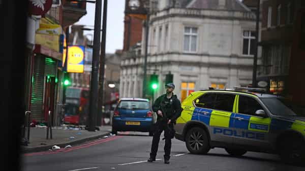 Police attend the scene after an incident in Streatham, London. (AP)
