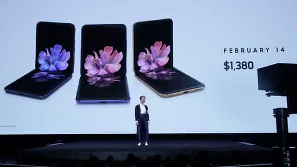 Rebecca Hirst, head of UK Mobile Product Development, speaks in front of photos of Samsung Galaxy Z Flip Phones at the Unpacked 2020 event in San Francisco. (AP)