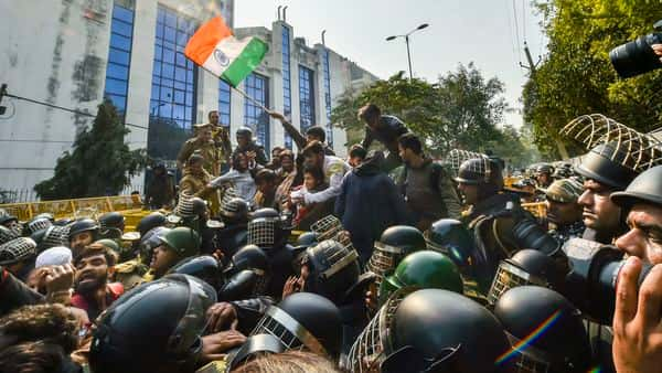 Police stop protestors during their march against the amended Citizenship Act, NRC and NPR, near Jamia Nagar in New Delhi. (PTI)