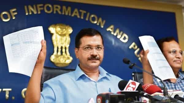 A file photo of Delhi chief minister Arvind Kejriwal announcing free electricity up to 200 units for the capital. (HT)