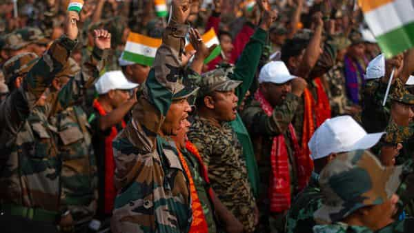 Cadres of the National Democratic Front of Bodoland (NDFB) shout slogan during event to celebrate signing of a peace accord in Kokrajhar, a town 250 kilometers (150 miles) west of Gauhati. (AP)