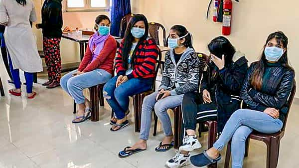 Indian nationals who were airlifted from coronavirus-hit Hubei province of China's Wuhan, at the ITBP's quarantine facility at Chhawla in New Delhi, Sunday (Photo: PTI)