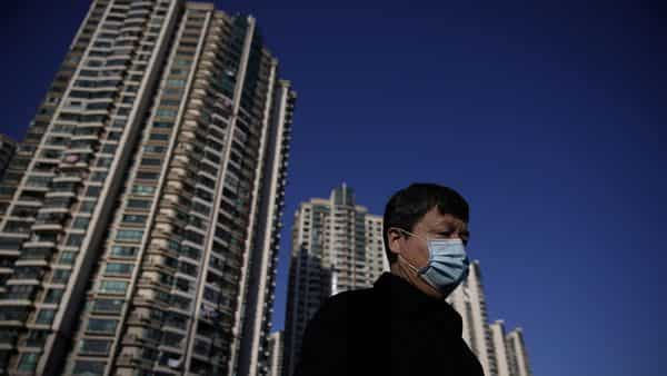 A man wearing a mask is seen on a street in Shanghai, China, as the country is hit by an outbreak of the novel coronavirus. (REUTERS)