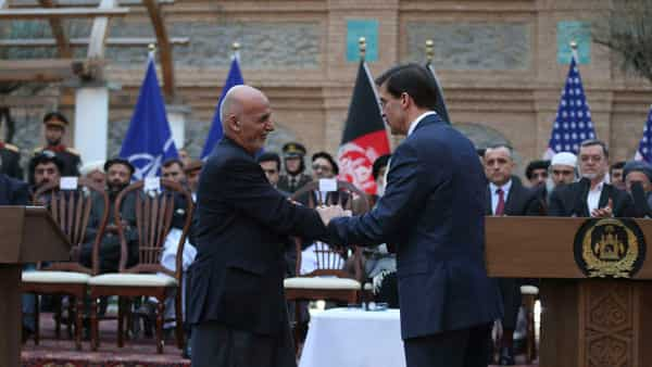 Afghan President Ashraf Ghani, left, shakes hands with U.S. Secretary of Defense Mark Esper, after a joint news conference in presidential palace in Kabul, Afghanistan, Saturday, Feb. 29, 2020. The U.S. signed a peace agreement with Taliban militants on Saturday aimed at bringing an end to 18 years of bloodshed in Afghanistan and allowing U.S. troops to return home from America's longest war.  (Photo: AP)