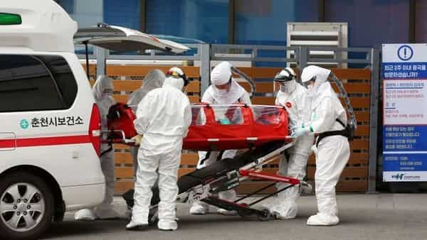 A confirmed coronavirus patient is wheeled to a hospital at Chuncheon, South Korea (Photo: Reuters)