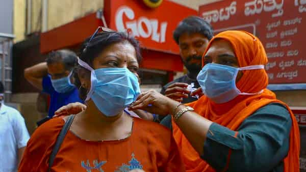 Social activists distribute masks in wake of the deadly coronavirus, at a metro station in Bengaluru. (PTI)