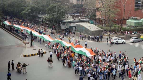 Members of Delhi Peace Form hold the tricolor flag as they take part in a peaceful march for the victims who died in the Delhi riots, in New Delhi on Saturday. (Photo: ANI)