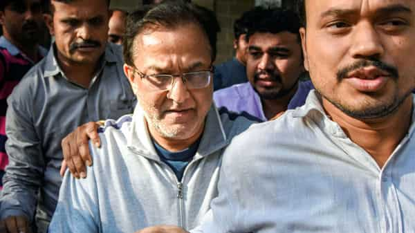 Yes Bank founder Rana Kapoor being taken to a court after being arrested by ED under money laundering charges, in Mumbai, on Sunday. (PTI)
