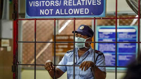 Security personnel wearing mask as preventive measure against the novel coronavirus, at Rajiv Gandhi Government General Hospital in Chennai. (PTI)