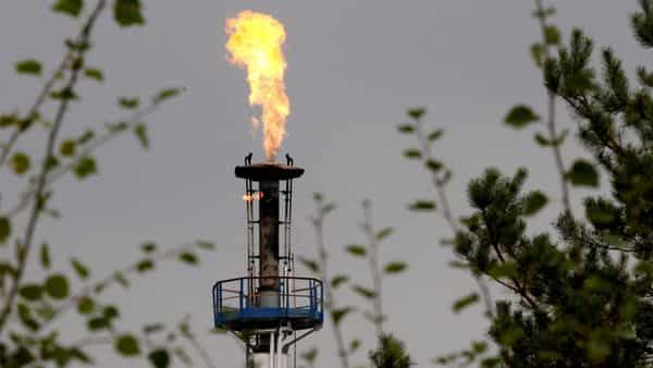 A flame burning natural gas is seen at an oil refinery. (Reuters )