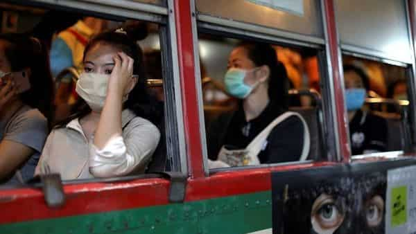 Women travel in a public bus wearing protective masks due to the coronavirus outbreak, in Bangkok, (REUTERS)