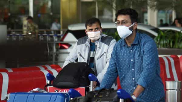 People wear a face mask to protect from Corona Virus at Andheri International Airport, in Mumbai.  (ANI )