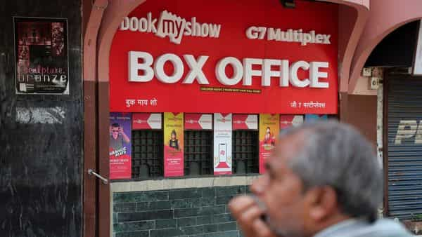 A man stands outside a multiplex after authorities closed cinemas as a precautionary measure against Covid-19 in Mumbai (Photo: AP)