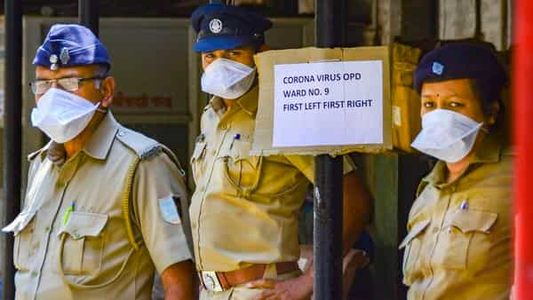 Security personnel wear masks to mitigate the spread of coronavirus, outside a special isolation ward at a Mumbai-based hospital (Photo: PTI)