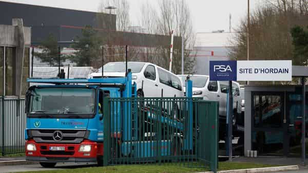 A truck carrying van leave the Sevelnord car plant as PSA Group announced the shutdown of its factories in France and Spain, due to the outbreak of coronavirus disease in Hordain, France (Photo: Reuters)