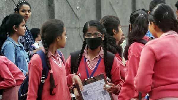 A student wears a mask as she arrives to appear in the CBSE exam, at Kondli in New Delhi on Thursday.  (ANI)