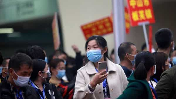A file photo of migrant workers wearing face masks to prevent the spread of coronavirus disease (COVID-19) in China. (REUTERS)