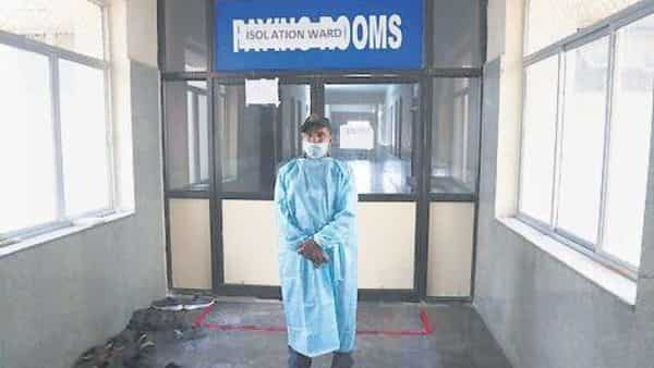 A medic outside a Covid-19 isolation ward at the Gandhi Hospital in Hyderabad on Monday.