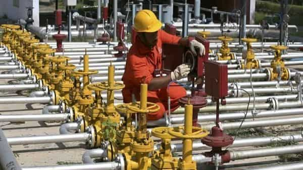 The oil ministry this week asked ONGC and Oil India to give `15,937.59 crore to make up for 40% of the `39,725 crore revenue that retailers lost. Photo: Amit Dave/Reuters
