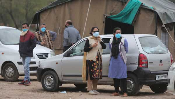 Doctors wear masks and stand outside isolation wards set up for possible COVID-19 patients in Jammu (AP)