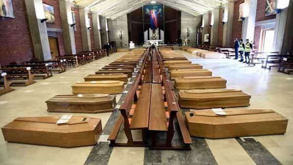 Coffins that have been piling up in a church due to a high number of deaths, are seen before they are taken away by military trucks, as Italy struggles to contain the spread of coronavirus, in Seriate, Italy (Photo: Reuters)