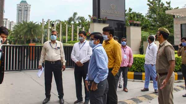 Noida: Officials seal the premises of hotel Sandal Suites after a suspected coronavirus infected traveller stayed there. (PTI)
