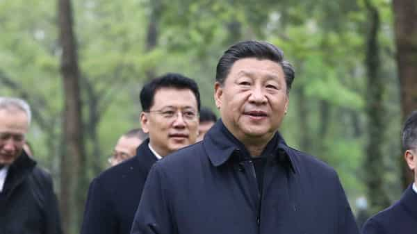Chinese President Xi Jinping, second right, visits the Xixi National Wetland Park during an inspection in Hangzhou (AP)