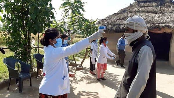 Medics use thermal screening on Villagers of Paniyala, as put them under home quarantine by authorities after a Tablighi Jamaat returnee tested positive for covid-19, in Haridwar. (ANI)