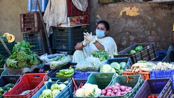 A vegetable seller wears gloves, in wake of coronavirus pandemic, during the nationwide lockdown, in New Delhi. (PTI)