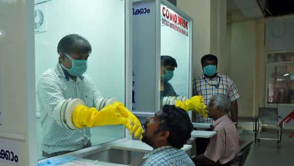 Active coronavirus cases in India rose to 4,643. Medical staff collect swabs from people to test for coronavirus.