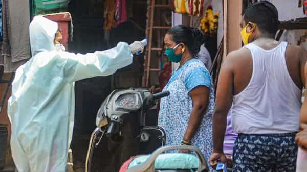 Mahim Dharavi Medical Practitioners Association conducts a thermal screening of residents of a housing society during a nationwide lockdown in the wake of coronavirus pandemic, at Dharavi in Mumbai. (Photo: PTI)