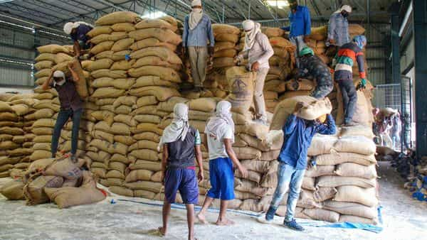 Labourers carry wheat sacks to load in trucks at Food Corporation of India warehouse during a nationwide lockdown to curb the spread of coronavirus (PTI)