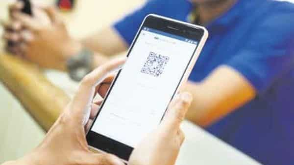 Digital payment firms such as PhonePe and Paytm have started focusing on changing the user interface for their respective mobile applications, to help assist in payments and delivery of essential services and items.(Photo: Hemant Mishra/Mint)