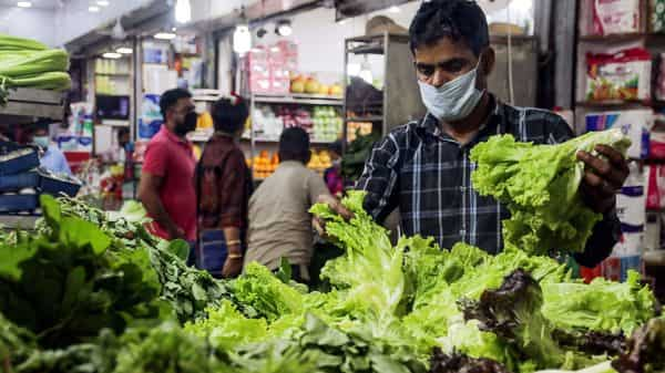 People wear mask during shopping at a grocery shop amid rising cases of COVID-19 in Delhi. (ANI )