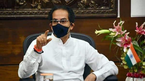 Maharashtra CM Uddhav Thackeray wears a mask while interacting with Prime Minister Narendra Modi.