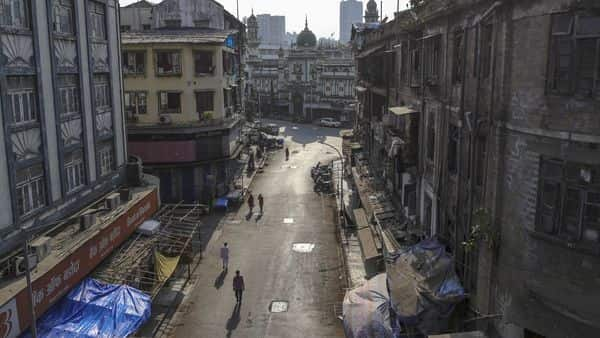 Pedestrians walk along the near-empty Mohammed Ali Road during a lockdown imposed due to the coronavirus in Mumbai (Photo: Bloomberg)