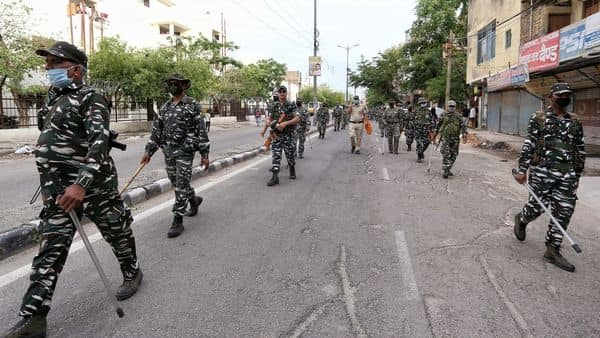 Paramilitary personnel march during the COVID-19 lockdown in New Delhi on Monday. (ANI Photo)