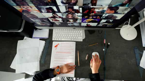 A student takes classes online with his companions using the Zoom APP at home during the coronavirus disease (COVID-19) outbreak (Reuters)