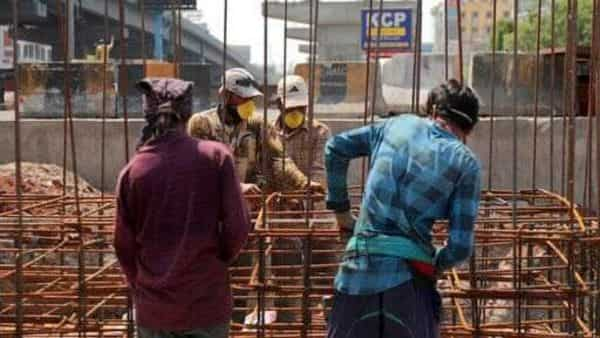 Indian laborers work on the construction of a flyover bridge during lockdown to prevent the spread of new coronavirus in Hyderabad, India (AP)