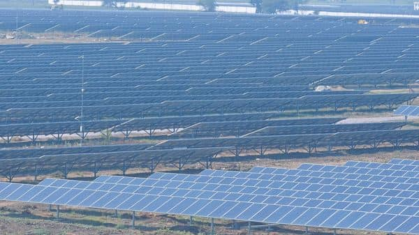 The proceeds of this sale will be primarily applied by the group towards debt reduction and a part will also be utilized for funding the group's under construction solar projects. Photo: Pradeep Gaur/Mint